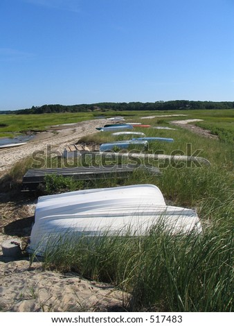 row of rowboats on Cape Cod - stock photo