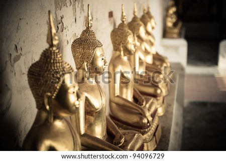 Row of Sacred Buddha images in Ayuthaya, Thailand