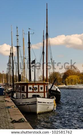 row of sailing boats mooring in stockholm bay - stock photo