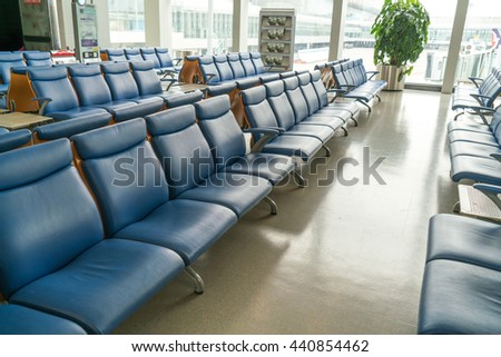 row of seat at Waiting lounge in an airport. - stock photo