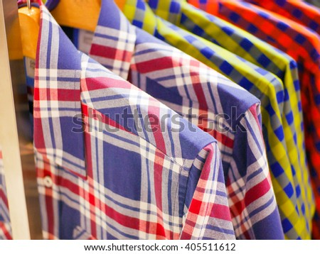 row of shirts - stripes garment collection textile style - stock photo