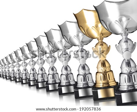 Row of silver trophies and one gold isolated on white  - stock photo