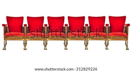 Row of six red vintage cinema chairs isolated on a white background - stock photo