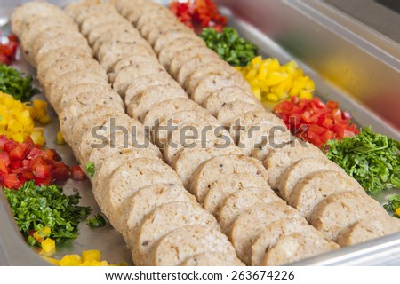 Row of sliced dumplings in a tray at hotel restaurant buffet - stock photo