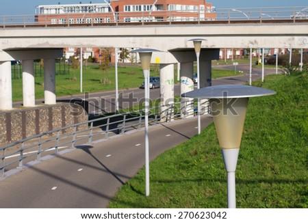 row of street lights along a bicycle lane - stock photo