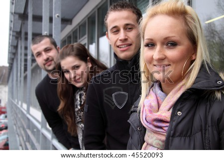 Row of students happy outdoors - stock photo