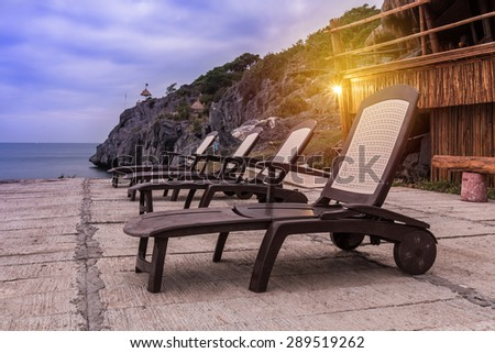 Row of sun bed in dusk. - stock photo