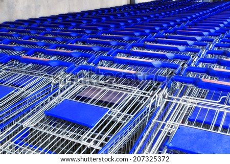 Row of supermarket shopping cart blue - stock photo