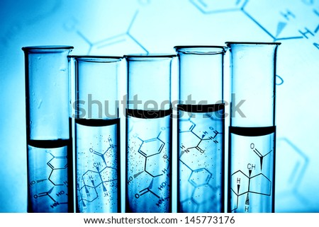 Row of test tubes in blue tone. - stock photo