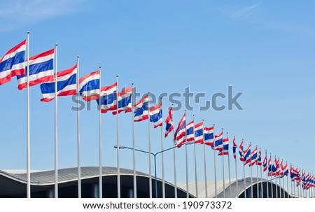 Row of thai flag and blue sky. - stock photo