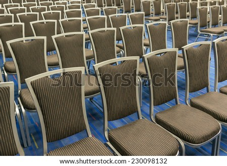 Row of the chairs in the large meeting room. - stock photo