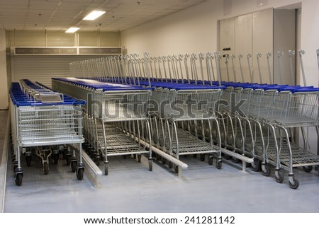 Row of the shopping carts in the supermarket  - stock photo