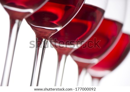 Row of the wine glasses on white background. Selective focus
