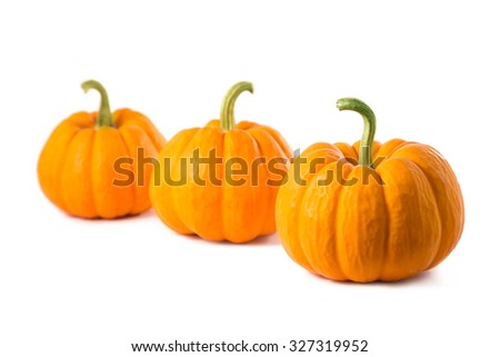 Row of three small pumpkins, isolated on white background  - stock photo