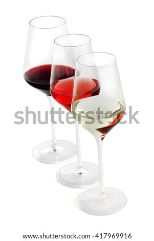 row of three wine glasses. Red wine, pink wine and white wine in the glass. Different sorts of whine. Sommelier - stock photo