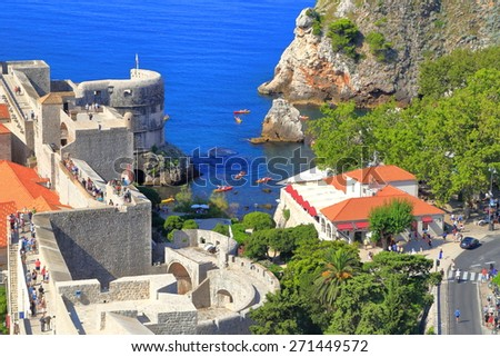 Row of tourists walking above the walls of Dubrovnik, Croatia - stock photo