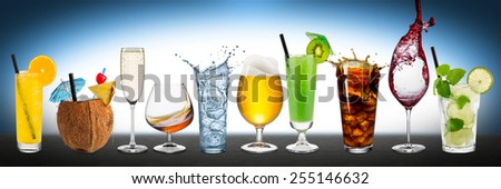 Row of various drinks on blue background - stock photo