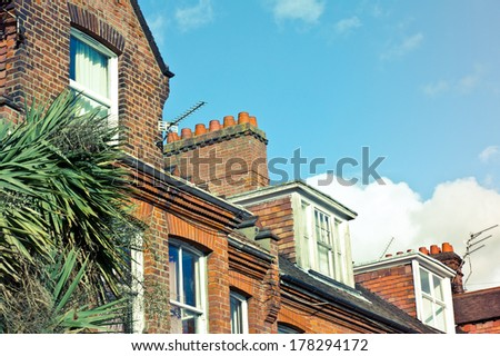 Row of victorian town houses in the UK with retro filter applied - stock photo