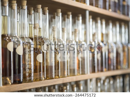 Row of vintage alcohol bottles - stock photo