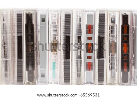Row of vintage audio tapes over white background - stock photo