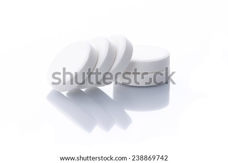 Row of vitamin pills isolated on a white background - stock photo