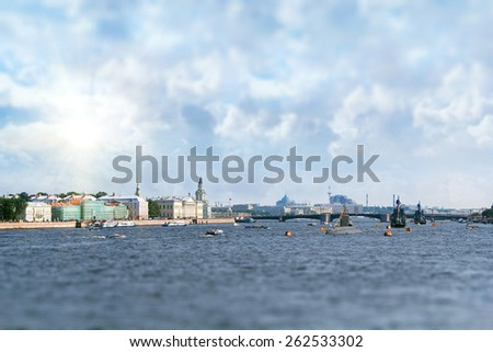 Row of warships in Neva river at sunrise. Picture with tilt shift effect. Shallow DOF - stock photo