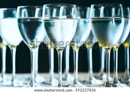 Row of water glasses. Pure drinking water. Selective focus.  - stock photo