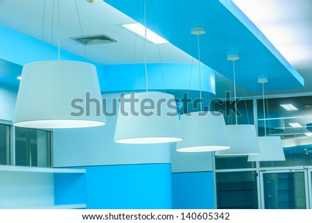 row of white ceiling lamp in library - stock photo