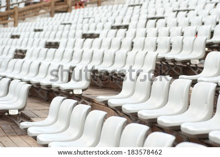Row of white seats in treater.