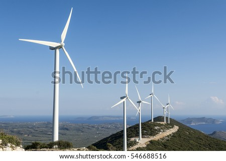 Row of wind turbines on a hill in an alternative energy concept