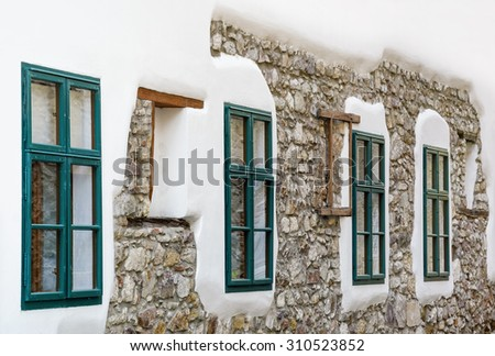Row of Windows of a House in Szekesfehervar, Hungary - stock photo