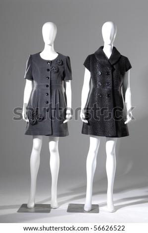 Row of Winter black coat dress on mannequin - stock photo
