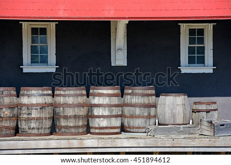 row of wooden barrel and crate on train platform - stock photo