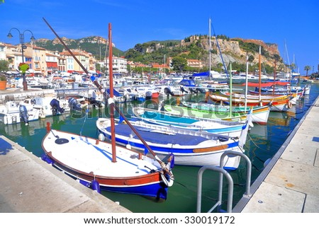 Row of wooden boats sheltered inside the harbor of Cassis, France - stock photo