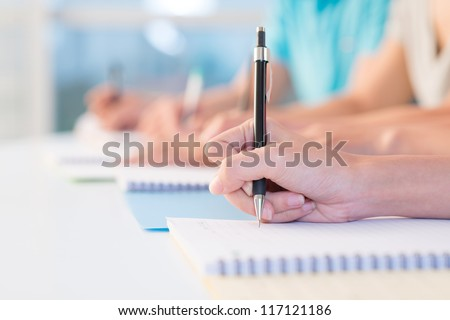 Row of writing hands - stock photo