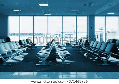 Row seats for passengers in the airport lobby. in the background of the events at the airport. Technical blue colored. - stock photo
