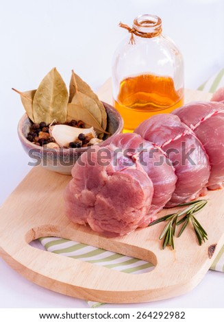 Row tenderloin with herbs on cutting board. - Steak preparing and ingredients. - stock photo