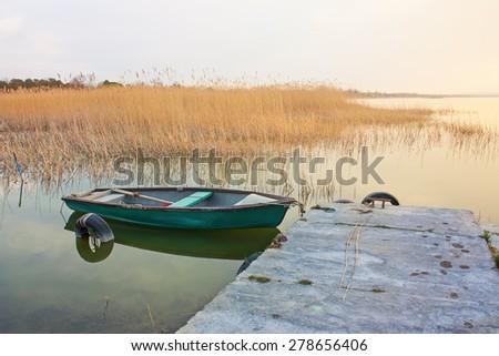 Rowboat anchored on the shore of Lake Balaton - stock photo
