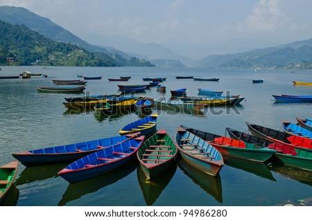 rowboat at phewa lake,pokhara,nepal - stock photo
