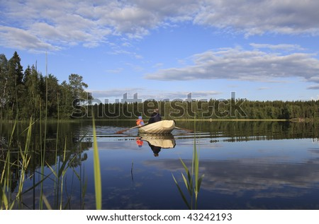 Rowboat on lake