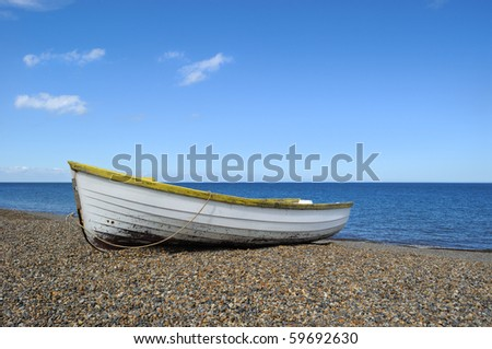 Rowboat on the beach in Norfolk - stock photo