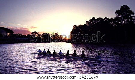 Rowers at Sunset on Adelaide's Torrens River - stock photo