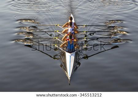 rowers paddling in a beautiful italian lake - stock photo
