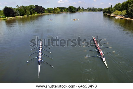 Rowers training, going and coming on a river.