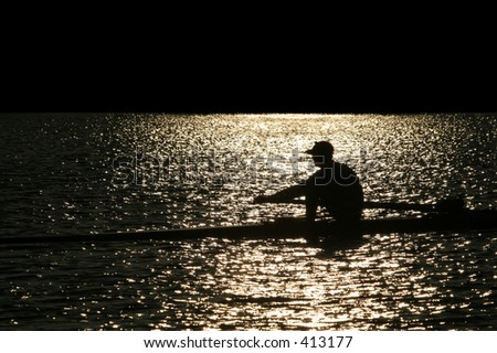 Rowing alone - stock photo