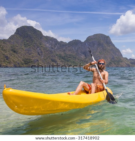 rowing in kayak - stock photo