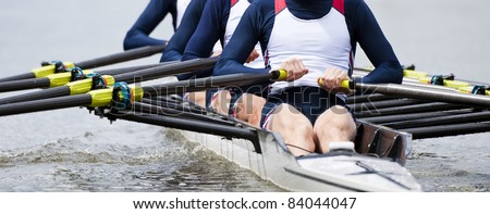 Rowing team at the start of a regatta - stock photo