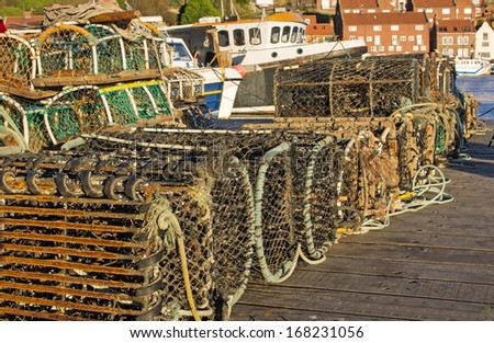 Rows a crab pots piled on the quay - stock photo