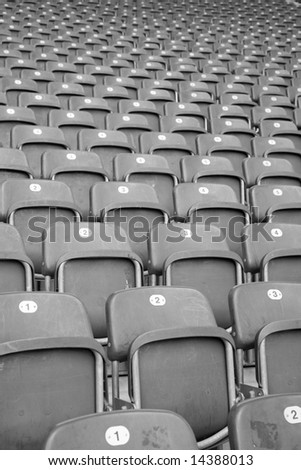 Rows and rows of empty seats in a football stadium - stock photo
