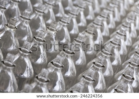 Rows and rows of glass bottles ready for recycling. - stock photo